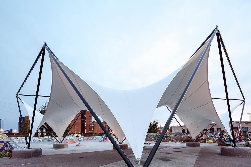 Nomad kitchen tent structure for Flow in Helsinki, Finland designed by Emmi Keskisarja & Pekka Tynkkynen.