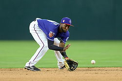 March 26, 2018 - Arlington, TX, U.S. - ARLINGTON, TX - MARCH 26: Texas Rangers short stop Jurickson Profar (19) fields a ground ball during the exhibition game between the Cincinnati Reds and Texas Rangers on March 26, 2018 at Globe Life Park in Arlington, TX. (Photo by Andrew Dieb/Icon Sportswire) (Credit Image: © Andrew Dieb/Icon SMI via ZUMA Press)