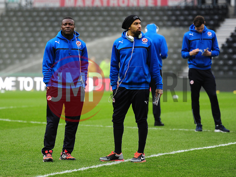 Reading's Yakubu Aiyegbeni (left) arrives at the I pro Stadium. - Photo mandatory by-line: Alex James/JMP - Mobile: 07966 386802 - 14/02/2015 - SPORT - Football - Derby  - ipro stadium - Derby County v Reading - FA Cup - Fifth Round