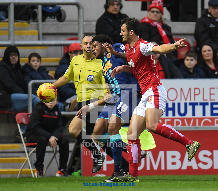 Farrend Rawson of Rotherham United and Chuba Akpom of Hull City during the Sky Bet Championship match at the New York Stadium, Rotherham<br /> Picture by Richard Land/Focus Images Ltd +44 7713 507003<br /> 19/12/2015