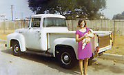 """October 17, 2010 - Modesto, California, U.S. - <br /> Stolen truck found after 38 years<br /> <br /> It only took them 38 years, but police in California finally found Harold Voelker's 1956 Ford F-100 truck which was stolen from Los Angeles in the early 1970's.<br /> """"I was shaking,"""" Volelker said when he got the call from Modesto Highway Patrol saying they believe they found the 1967 truck he reported stolen in the summer of 1972.<br /> The years passed and Voelker went on with his life: oil painting and collecting cars.<br /> Since the theft in 1972, the truck has had at least two different """"owners"""" including the couple that surrendered the Ford plus a Modesto woman who was given the truck by her father in Texas and had owned it for 11 years.<br /> Two weeks ago, when the Modesto couple took the pickup for it's annual registration, a Dept. of Motor Vehicles official was suspicious of the Vehicle Identification Number. It appeared the vehicle's original VIN had been covered with a false number. But the VIN number on the truck's door didn't match the one in the cabin interior.<br /> Not everything is back the way it was - almost. When it was stolen the truck was yellow, since then, it has been painted a pristine white. According to Voelker, someone must have really put some money into the truck. it now has alloy wheels and has even had a brand new engine put in since it was stolen. """"It's better than when I last had it in 1972,"""" said Voelker.<br /> PICTURED: Harold Voelker's 1956 Ford F-100 pickup before it was stolen in undated family photo.<br /> (Credit Image: ©Terry Miller/Exclusivepix)"""