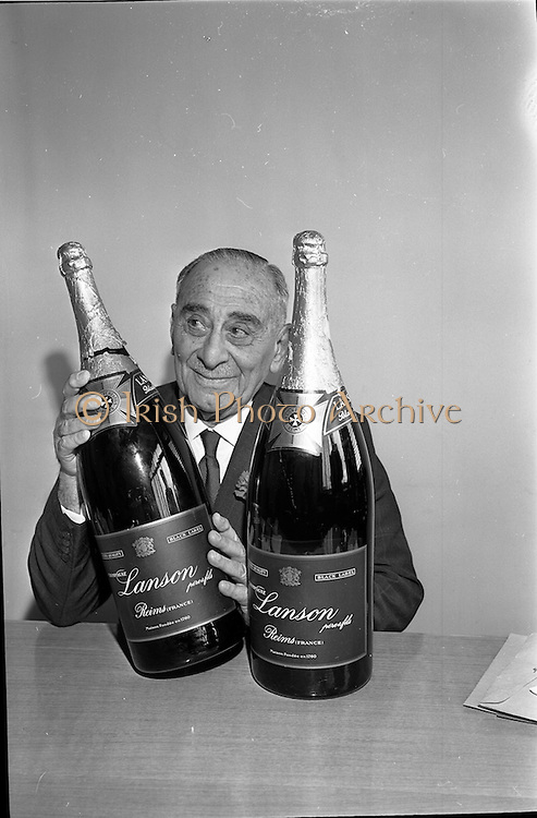 03/08/1962<br /> 08/03/1962<br /> 03 August 1962<br /> Champagne arrives for Horse Show Week Party. Two Lanson Black label Methusalahs (each equal to eight normal bottles) bottles of Champagne were specially flown from Reims, France for Mr Robert West Waffendan's Horse Show Week Party at the Candle Light Restaurant, Shangri-La Hotel, Dalkey, Dublin the next Monday night. Picture may show Mr Waffendan.