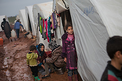 A young girl stands in front of her family tent early morning inside Atmah's refugee camp Idlib province, Syria. Situated along the Turkish border Atmah's refugee camp is considered the biggest refugee camp inside Syria's territory with an estimated number of 13,000 refugees and growing by the day. Is the biggest in an area with another two camps.,000 refugees and growing by the day. Is the biggest in an area with another two camps, Syria, February 5, 2013. Photo by Daniel Leal-Olivas / i-Images.
