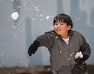 "A boy throws snow balls during the annual ""Christmas in July"" event at the Union Rescue Mission in the Skid Row area of Los Angeles, California on Wednesday, July 10, 2013. (Photo by Ringo Chiu/PHOTOFORMULA.com)"