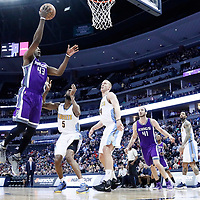 06 March 2017: Sacramento Kings forward Anthony Tolliver (43) goes for the layup past Denver Nuggets guard Will Barton (5) and Denver Nuggets center Mason Plumlee (24) during the Denver Nuggets 108-96 victory over the Sacramento Kings, at the Pepsi Center, Denver, Colorado, USA.