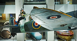 &copy; Licensed to London News Pictures. 01.02.18 London, UK.  A specialist team from Arco Total Access are suspended by ropes to dust a Supermarine Spitfire Mark1A at the Imperial War Museum, London. The rare aircraft is one of few remaining in it&rsquo;s original 1940's paint and is given a clean-up every three years.<br />