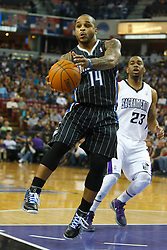 Jan 8, 2012; Sacramento, CA, USA; Orlando Magic point guard Jameer Nelson (14) dribbles past Sacramento Kings guard Marcus Thornton (23) during the first quarter at Power Balance Pavilion. Mandatory Credit: Jason O. Watson-US PRESSWIRE