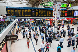 © Licensed to London News Pictures. 05/07/2018. London, UK. Passengers wait at London Victoria, where there is significant disruption to train services. Commuters have been advised not to travel after a major power loss which is expected to continue throughout the day. Photo credit: Rob Pinney/LNP