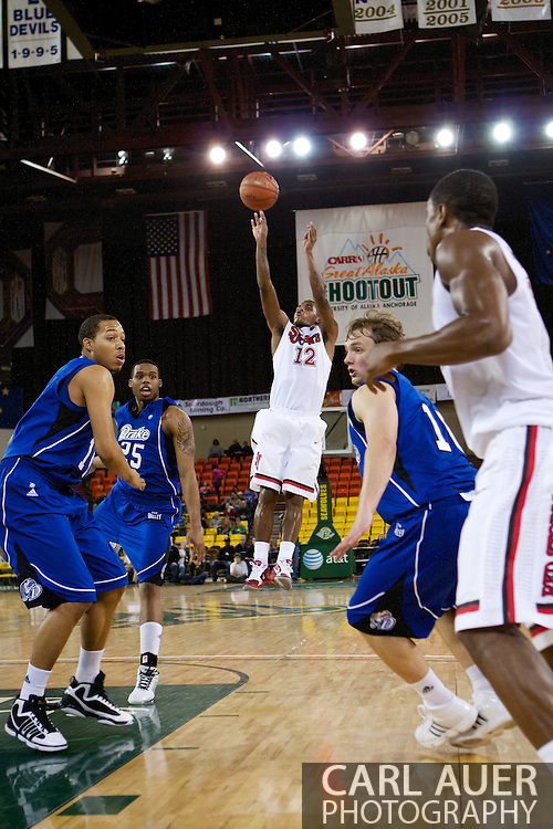 November 26th, 2010:  Anchorage, Alaska - St. John's senior guard Dwight Hardy (12) attempts a shot in the Red Storm's semi final game of the Great Alaska Shootout against the Drake Bulldogs.  The Red Storm defense held Drake to a tournament low score as St. Johns advanced to the final game 82-39.