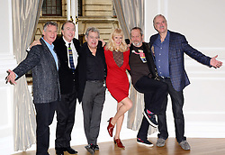 L to R Michael Palin, Eric Idle, Terry Jones,Terry Gilliam,  John Cleese pose for photographers with Carol Cleveland at the <br /> Photocall for the Monty Python reunion. London, United Kingdom. Thursday, 21st November 2013. Picture by Nils Jorgensen / i-Images