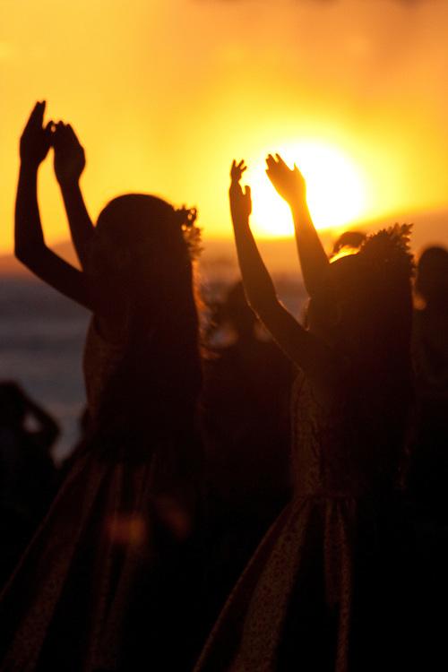 Young girls hula dance at sunset