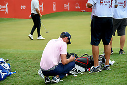 October 13, 2018 - Kuala Lumpur, Malaysia - Chesson Hadley of United States signs autographs golf balls for fans during the third round of the CIMB Classic at TPC Kuala Lumpur on 13 October, 2018 in Kuala Lumpur, Malaysia  (Credit Image: © Chris Jung/NurPhoto via ZUMA Press)
