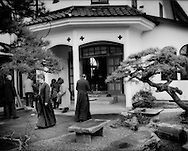 Father Clement Shinichi Kodama (walking to the left) of the Holy Annunciation Cathedral of Sendai outside the Russian Orthodox Church in Ishinomaki before a memorial ceremony for the 11 March 2011 earthquake and tsunami.  Ishinomaki, Miyagi Prefecture, Japan.