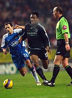 Photo: Paul Greenwood.<br />Wigan Athletic v Chelsea. The Barclays Premiership. 23/12/2006. Wigan's Josip Skoko, left, loses out to Chelsea's John Obi Mikel