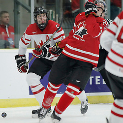 COBOURG, - Dec 16, 2015 -  Game #9 - Canada East vs Canada West at the 2015 World Junior A Challenge at the Cobourg Community Centre, ON. Kyle Betts #29 of Team Canada West gets a stick in the face during the second period<br /> (Photo: Amy Deroche / OJHL Images)