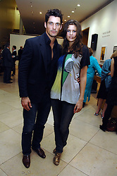 DAVID GANDY and CHLOE PRIDHAM at a private view of Bryan Adam's photographs entitled 'Modern Muses' held at The National Portrait Gallery, London on 11th March 2008.<br />