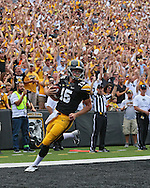 September 07 2013: Iowa Hawkeyes quarterback Jake Rudock (15) scores on a 6 yard rushing play during the first quarter of the NCAA football game between the Missouri State Bears and the Iowa Hawkeyes at Kinnick Stadium in Iowa City, Iowa on September 7, 2013. Iowa defeated Missouri State 28-14.