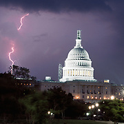 Washington, June 5, 2002 - Lightning strikes near the U.S. Capitol Building during a twilight thunderstorm in Washington on June 5, 2002.