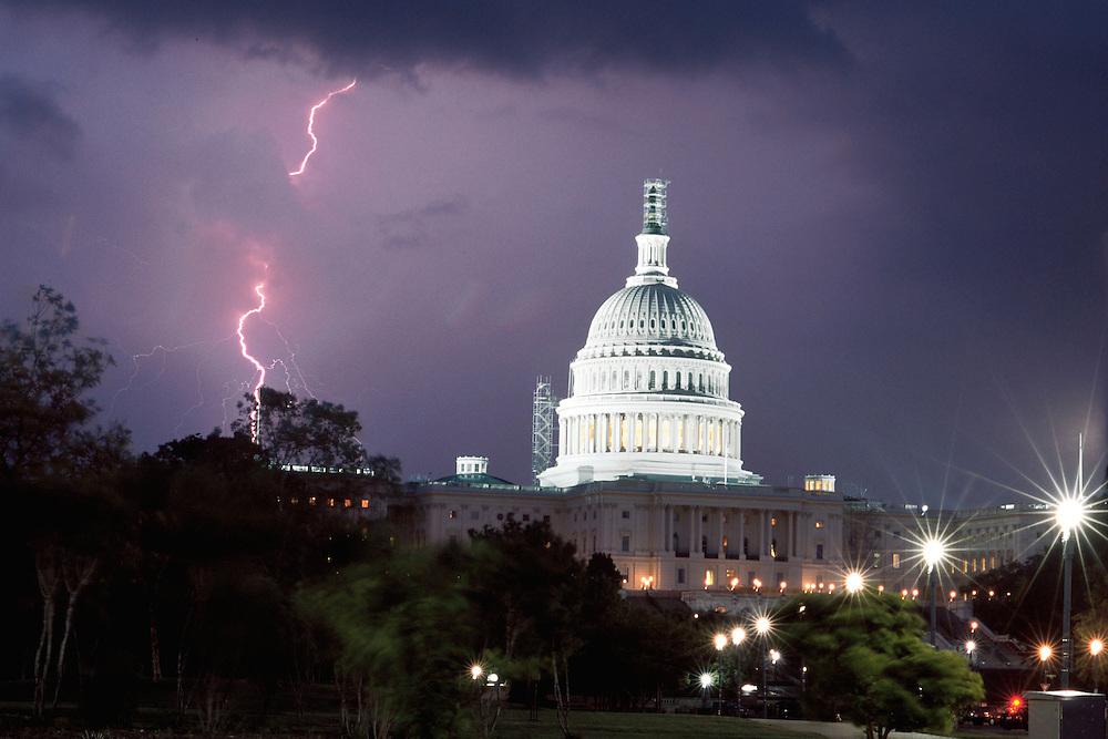 Washington, June 5, 2002 - Lightning strikes near the U.S. Capitol Building during a twilight thunderstorm in Washington on June 5, 2002.