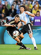 CAPE TOWN, SOUTH AFRICA- Saturday 3 July 2010, Miroslav Klose gets challenged by Martin Demichelis during the quarter final match between Argentina and Germany held at the Cape Town Stadium in Green Point during the 2010 FIFA World Cup..Photo by Roger Sedres/Image SA