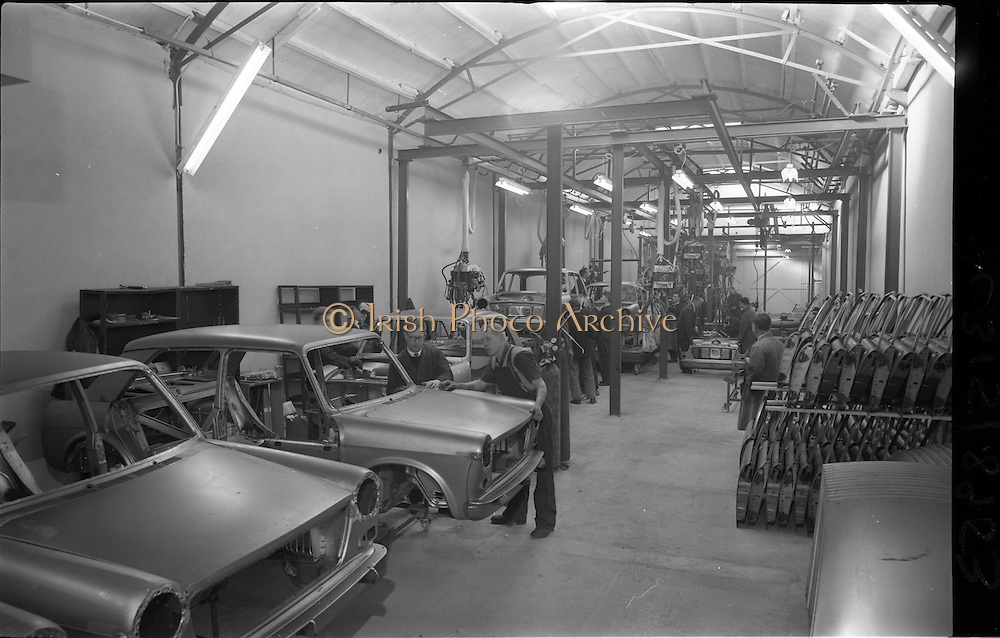 03/02/1964<br /> 02/03/1964<br /> 03 February 1964 <br /> Lincoln and Nolan new assembly shop, East Road, East Wall, Dublin. The line was built specially for the assembly of the new Austin 1100. Image shows workers assembling the cars, note stack of doors on right.