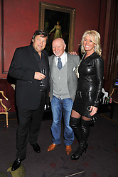 Left to right, GARY PASK, SIR TOM HUNTER and SHARON PASK at the 39th birthday party for Nick Candy in association with Ciroc Vodka held at 5 Cavindish Square, London on 21st Januatu 2012.