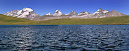 A view of the entire Gran Paradiso range seen from Lake Rosset, a glacial lake at almost 3000 mt. of elevation in the heart of the Gran Paradiso National Park. Taken on a beautiful sunny day of July, this is stitched from nine vertical frames.