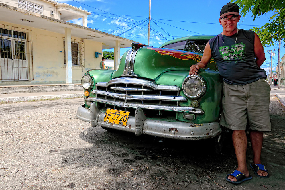 Man with his car in Santa Cruz del Norte, Mayabeque, Cuba.