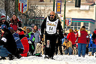 "04 March 2006: Anchorage, Alaska - Former wrestler ""Precious"" Paul Ellering walks towards the start line at the Ceremonial Start in downtown Anchorage of the 2006 Iditarod Sled Dog Race"