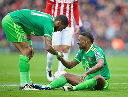 STOKE-ON-TRENT, ENGLAND - Saturday, April 30, 2016: Sunderland's Jermain Defoe is congratulated by team-mate Yann M'Vila after winning an injury time 93rd minute penalty against Stoke City during the FA Premier League match at the Britannia Stadium. (Pic by David Rawcliffe/Propaganda)