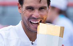 Rafael Nadal, of Spain, bites the trophy after beating Daniil Medvedev, of Russia, in the final at the Rogers Cup tennis tournament, in Montreal on Sunday, Aug. 11, 2019. Photo by Paul Chiasson/CP/ABACAPRESS.COM