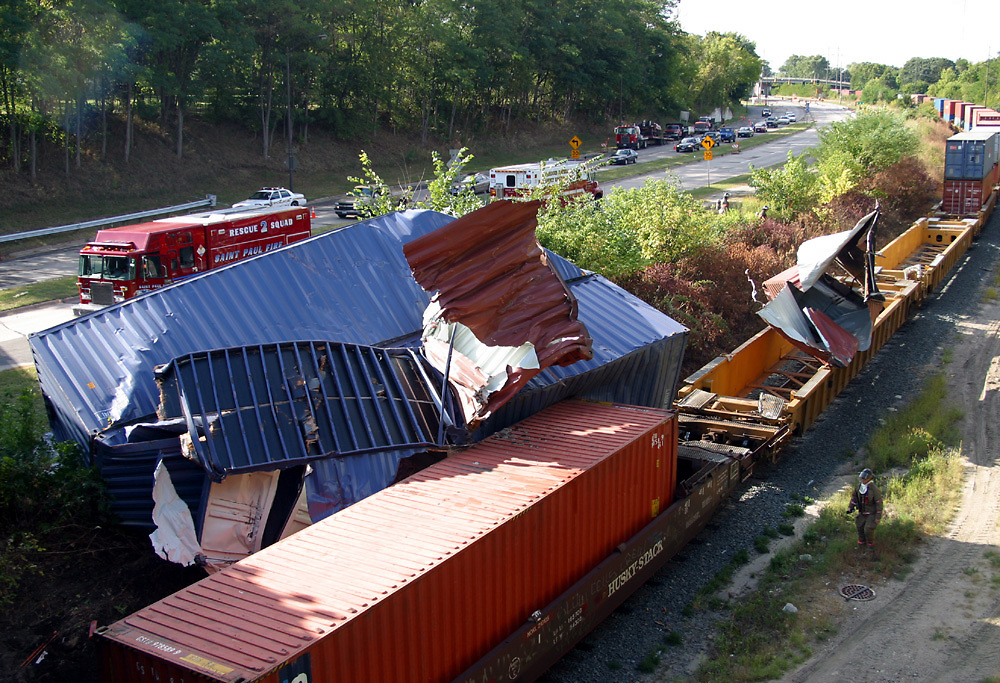 A Freight train stacked too high collides with the Summit Avenue overpass of Ayd Mill Road in St. Paul, MN. (Charles Hall/Special to the Star Tribune)