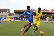 Lyle Taylor of AFC Wimbledon and Chey Dunkley of Oxford United FC tussle during the Sky Bet League 2 match between AFC Wimbledon and Oxford United at the Cherry Red Records Stadium, Kingston, England on 27 February 2016. Photo by Stuart Butcher.