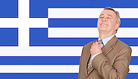 Middle-aged businessman adjusting necktie with pride over Greek flag
