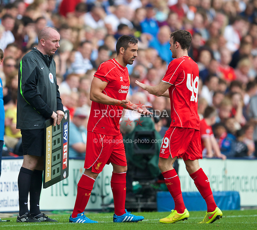 PRESTON, ENGLAND - Saturday, July 19, 2014: Liverpool's substitute Jose Enrique replaces Krisztian Adorjan against Preston North End during a preseason friendly match at Deepdale Stadium. (Pic by David Rawcliffe/Propaganda)