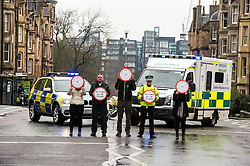 """Pictured: Superintendent Fraser Candlish, from Police Scotland, and John Alexander from Scottish Ambulance Service, were joined on a crossing to high;light atat every nine minutes an accident happens.<br /> The """"In Town, Slow Down""""  road safety campaign was launched today in Edinburgh to encourage drivers to watch their speed in built-up areas, amid figures showing someone is stopped for speeding in Scotland every nine minutes. Superintendent Fraser Candlish from Police Scotland, and John Alexander from Scottish Ambulance Service were on hand to help with the launch<br /> Ger Harley 