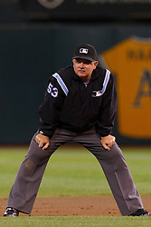 September 20, 2011; Oakland, CA, USA;  MLB umpire Greg Gibson (53) stands in the infield during the third inning between the Oakland Athletics and the Texas Rangers at O.co Coliseum.  Texas defeated Oakland 7-2.