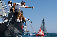 Mutua Madrilena rounds the leeward mark during Race 2 of the AUDI Medcup in Cagliari