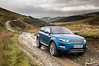 Range Rover Evoque 9-Gear Automatic put through it's off road paces climbing a mountain in Wales.<br /> The automotive photography was taken for the Green Car Guide to test out it's off road ability on a mountain track that hasn't been repaired for over two years. Rocks, mud, water, rough terrain and large holes were no problem for for the new automatic.