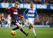 Ipswich Town Striker Freddie Sears looks to get passed Queens Park Rangers defender Paul Konchesky during the Sky Bet Championship match between Queens Park Rangers and Ipswich Town at the Loftus Road Stadium, London, England on 6 February 2016. Photo by Andy Walter.