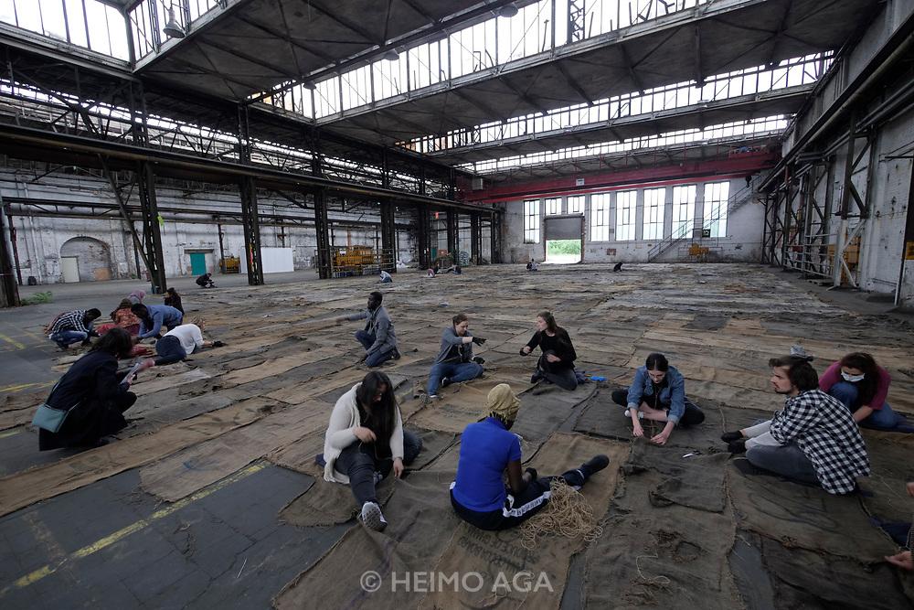 Kassel, Germany. Opening days of documenta14.<br /> Henschelhallen.<br /> Ibrahim Mahama (Ghana): Check Point Sekondi Loco
