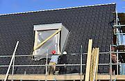 Nederland, Nijmegen, 27-2-2014 Bouwplaats voor huizen in de nieuwe wijk Laauwik, onderdeel van de stadsuitbreiding Waalsprong van Nijmegen in Lent. Er worden hier veel verschillende woningtypen gebouwd, zowel voor sociale huur, koop en vrije sector. Foto: Flip Franssen/Hollandse Hoogte