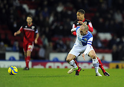Bristol City's Bobby Reid robs Blackburn Rovers' Danny Murphy of the ball - Photo mandatory by-line: Joe Meredith/JMP  - Tel: Mobile:07966 386802 05/01/2013 - Blackburn Rovers v Bristol City - SPORT - FOOTBALL - FA Cup -  BLACKBURN - EWOOD PARK -
