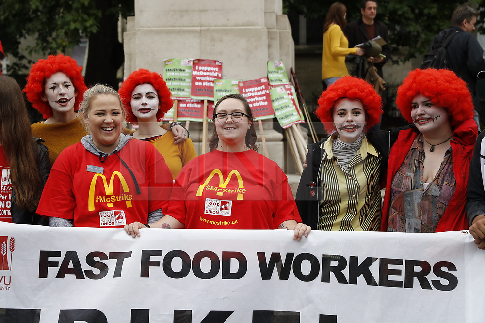 © Licensed to London News Pictures. 04/09/2017. London, UK. Striking McDonald's workers and their supporters hold a rally outside Parliament. Workers at two restaurants in Cambridge and London have voted to take industrial action in the first ever strike at the fast-food chain in the UK. Employees are seeking better working conditions and the end of zero-hour contracts. Photo credit: Peter Macdiarmid/LNP