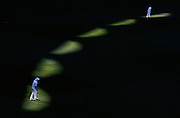 Picture taken at the GABBA Cricket Ground in Brisbane during the first days play, of the first cricket test between Australia and England .<br /> Picture shows.Englands Paul Collingwood and James Anderson field out on the boundary late in the afternoon.<br /> Commissioned by Sydney Morning Herald