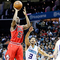 03 November 2015: Chicago Bulls guard E'Twaun Moore (55) takes a jump shot past Charlotte Hornets guard Jeremy Lamb (3) during the Charlotte Hornets  130-105 victory over the Chicago Bulls, at the Time Warner Cable Arena, in Charlotte, North Carolina, USA.