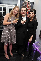 Left to right, SUSAN PARKES, CHARLIE ELIASCH and JUSTINE GLENTON at the after party for the press night of 'As I Like It' held at the home of Amanda Eliasch, 24 Cheyne Walk, London on 5th July 2011.