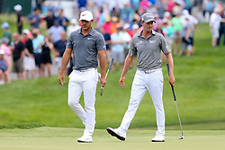 June 22, 2018 - Cromwell, Connecticut, United States - Brooks Koepka (L) and Webb Simpson walk the 8th green during the second round of the Travelers Championship at TPC River Highlands. (Credit Image: © Debby Wong via ZUMA Wire)
