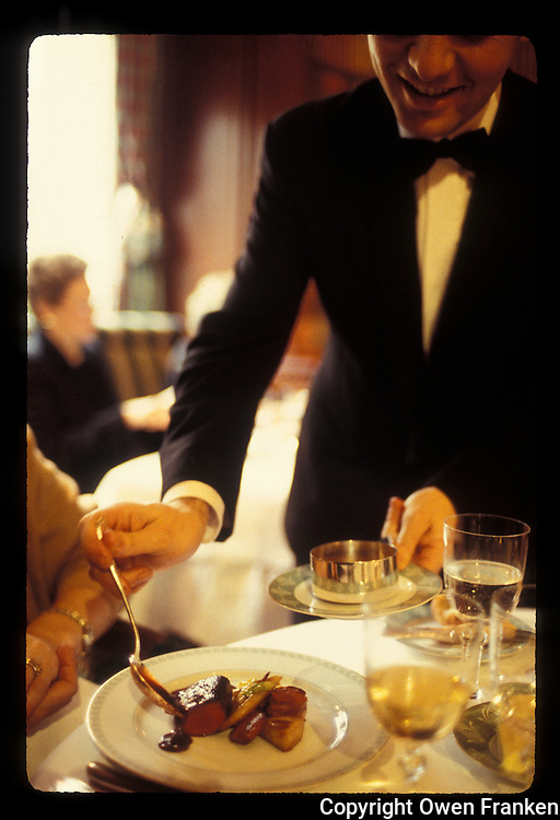 Waiter saucing venison at restaurant Alain Ducasse, Paris- Photograph by Owen Franken - Photograph by Owen Franken