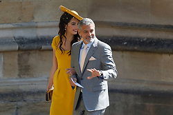 Amal Clooney and George Clooney arrive at St George's Chapel at Windsor Castle for the wedding of Prince Harry and Meghan Markle.